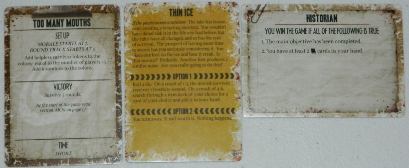 COG Gaming review - Dead of Winter crossroads card, objective card, and secret individual objective card.