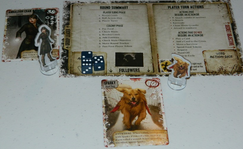COG Gaming - Dead of Winter zombie survival board game player board setup with Annaleigh Chan and Sparky the stunt dog.